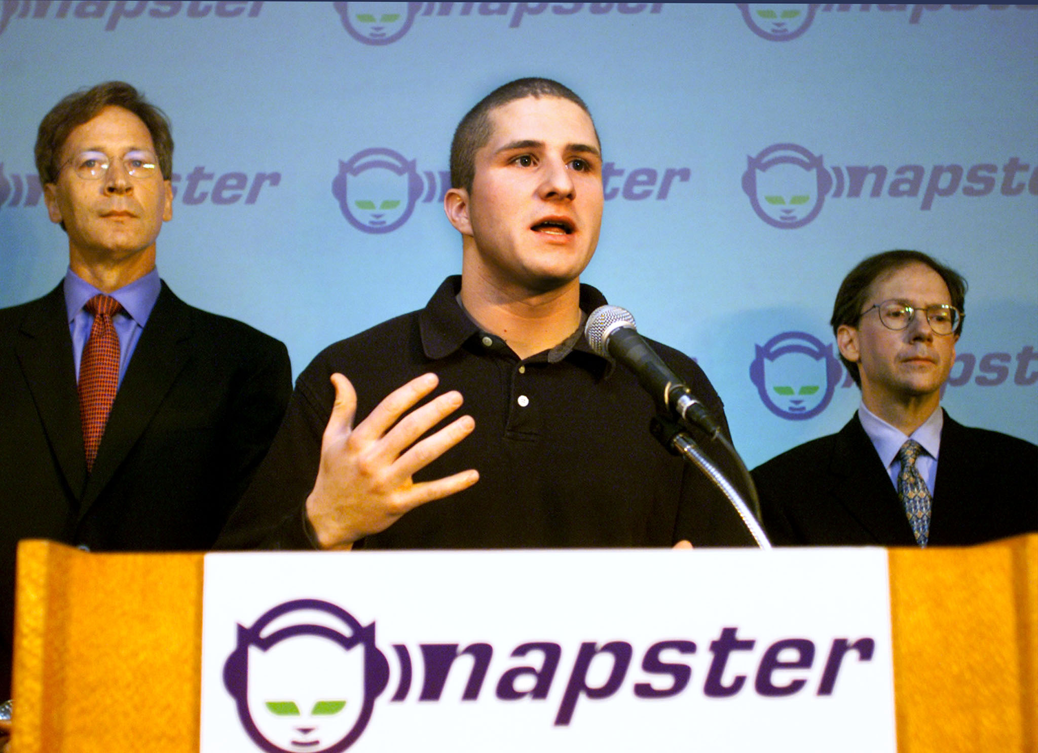 Flanked by Napster attorney Jonathan Schiller (L) and CEO Hank Barry, Napster founder Shawn Fanning