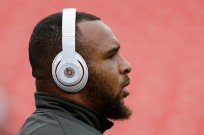A football players wearing headphones.