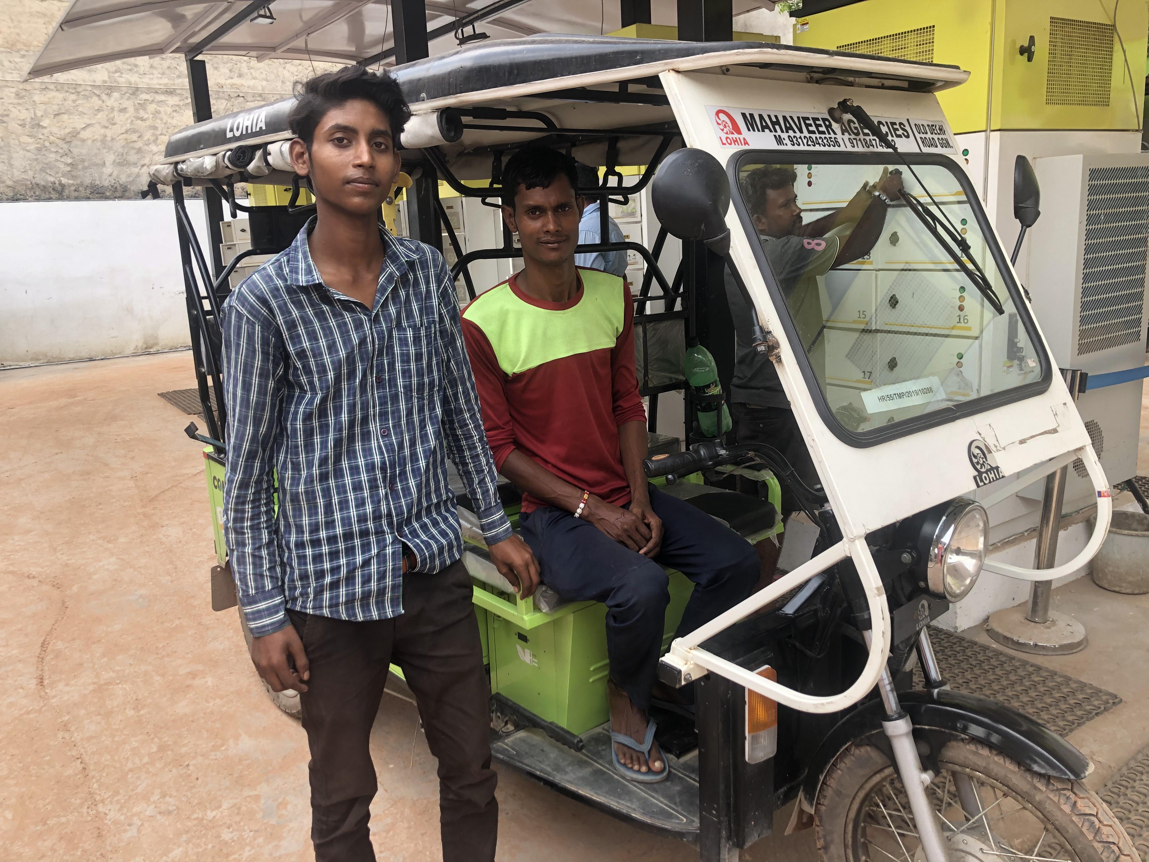 E-rickshaw owners Arun and Devendra Kumar.