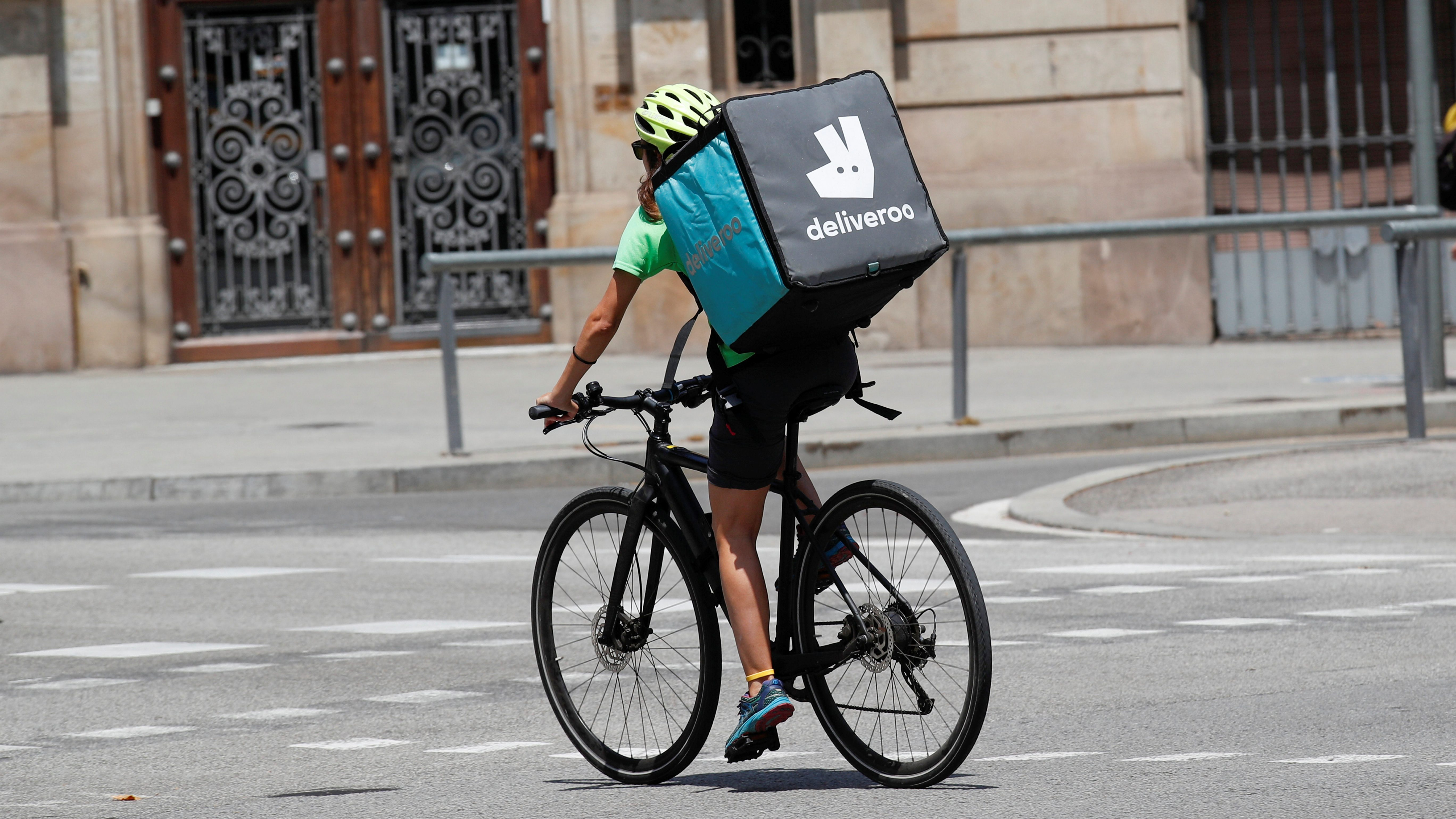 A Deliveroo rider on his bike