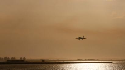 A plane flies over the Etang de Berre as it prepares to land on the tarmac of Marseille Provence Airport in Marignane, southern France