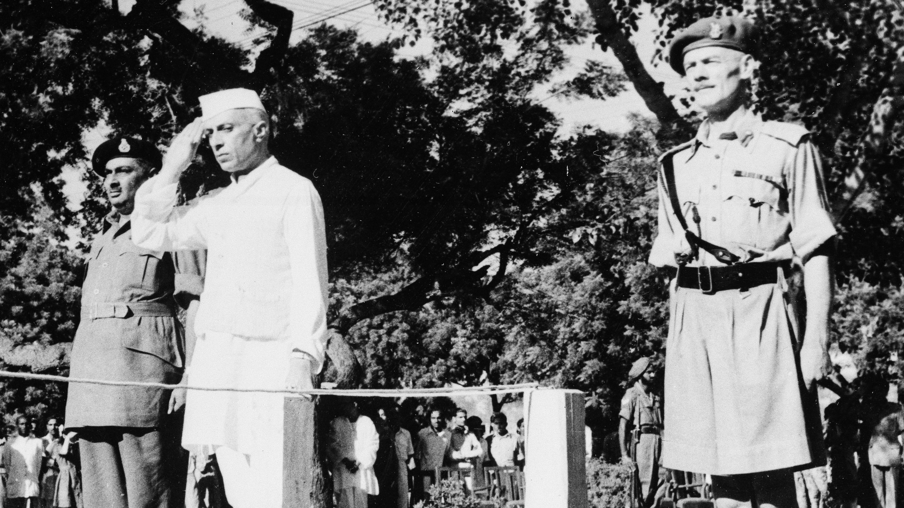 Jawaharlal Nehru salutes the flag as he becomes independent India's first prime minister on August 15, 1947 during the Independence Day ceremony at Red Fort, New Delhi, India.