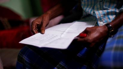 Ayub Salm holds the draft list of the National Register of Citizens (NRC) of his family in Dhubri district.