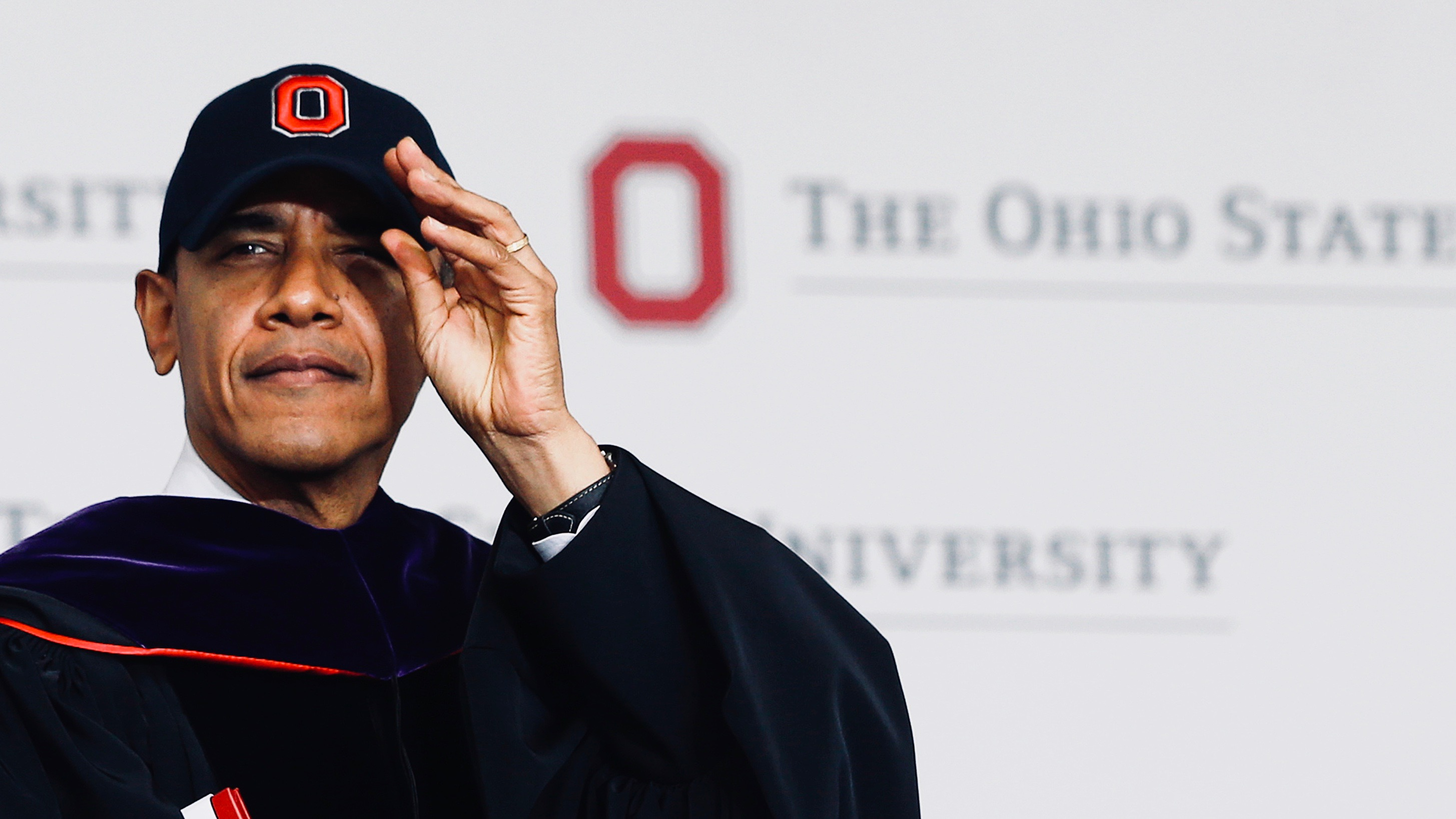 Barack Obama dons an Ohio State University cap