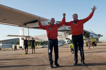Pilots Bertrand Piccard, left and Andre Borschberg, right, celebrate the landing of the solar-powered plane at San Pablo airport in Seville, Spain on Thursday, June 23, 2016. An experimental solar-powered airplane Thursday completed an unprecedented three-day flight across the Atlantic in the latest leg of its globe-circling voyage. (AP Photo/Laura Leon)