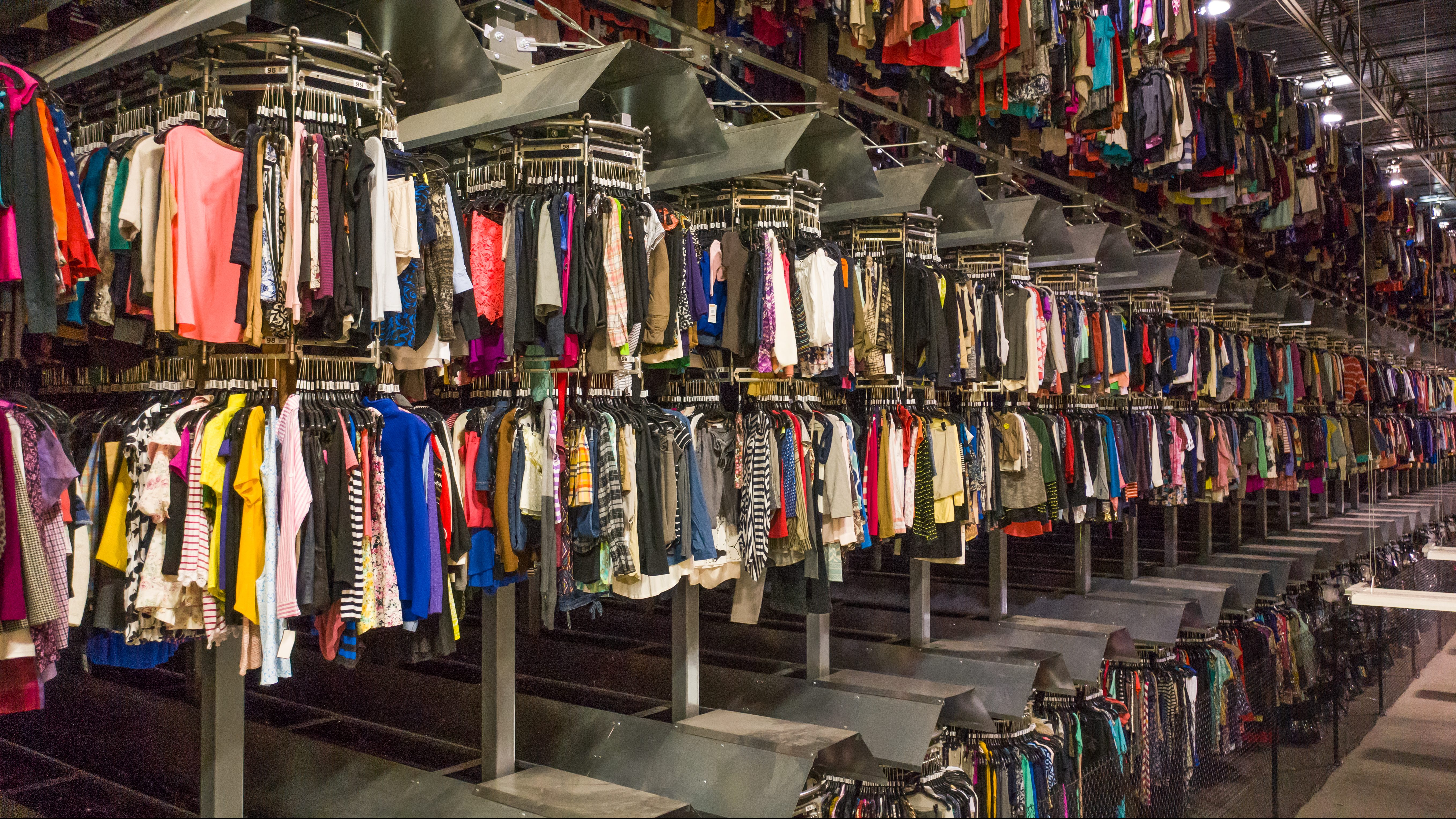 A warehouse containing racks full of used clothes