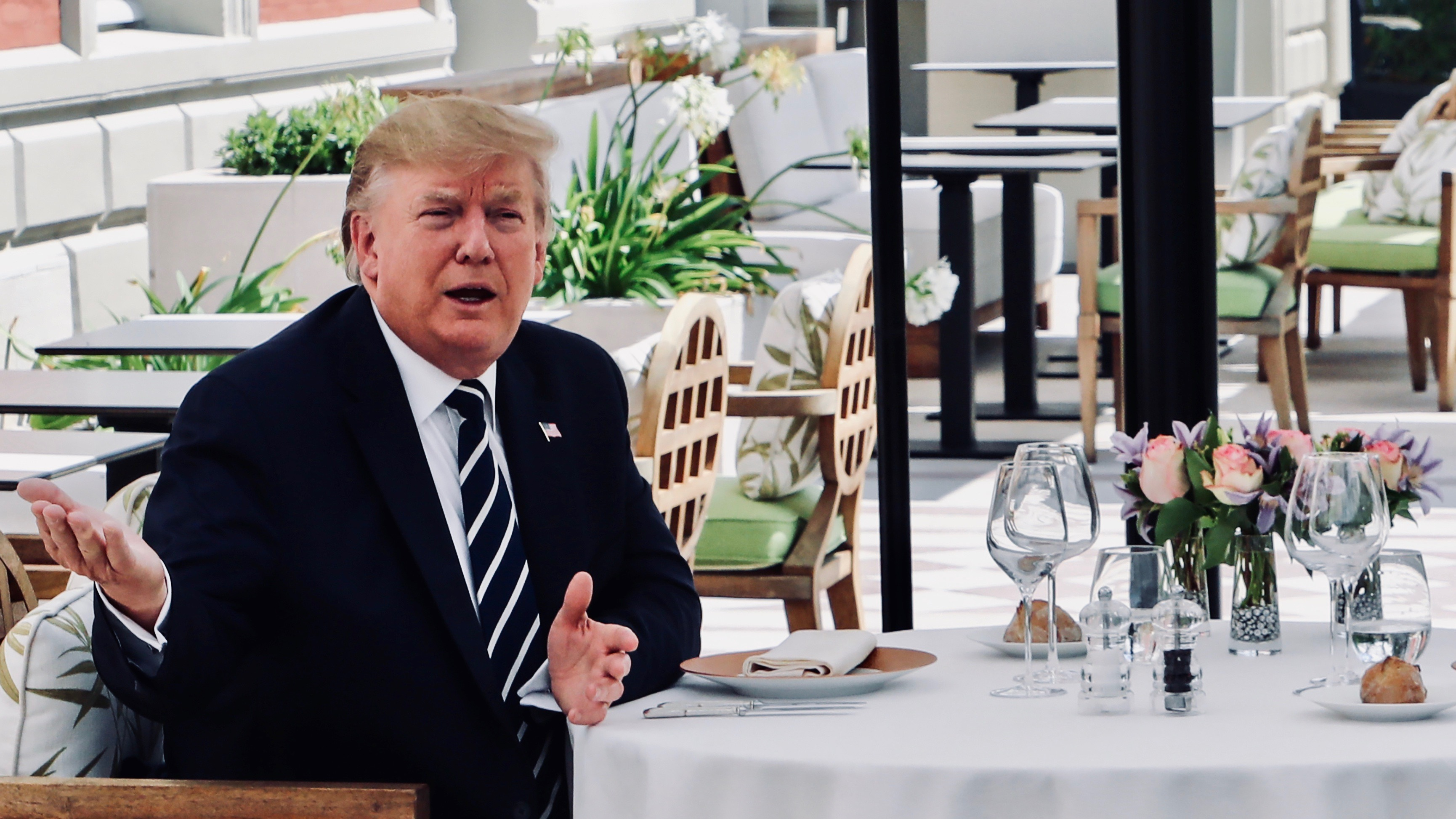 U.S. President Trump sits to lunch with French President Macron at Hotel du Palais in Biarritz.