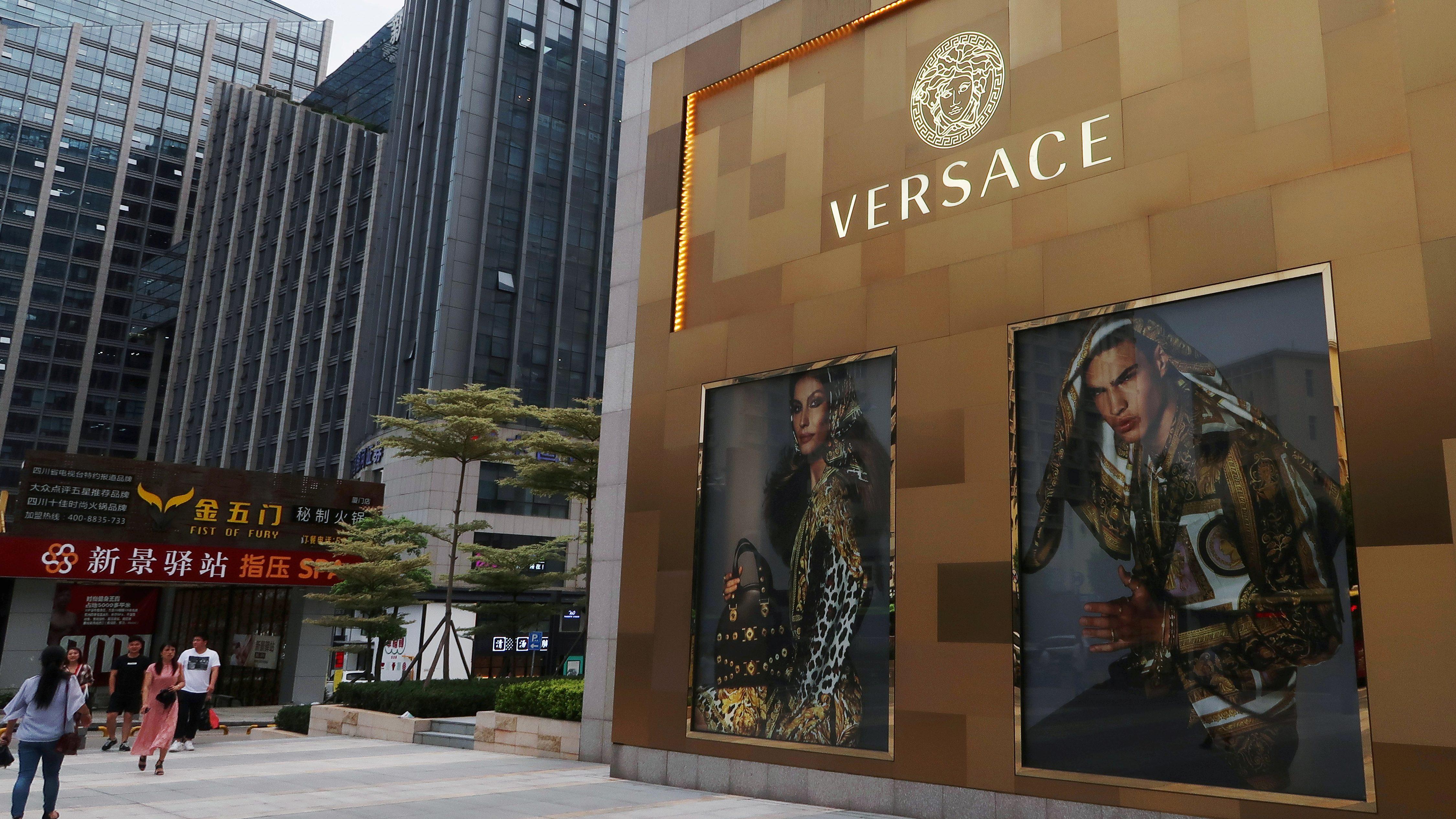 Shopping windows of Italian luxury brand Versace are seen outside a shopping mall in Xiamen, Fujian province.