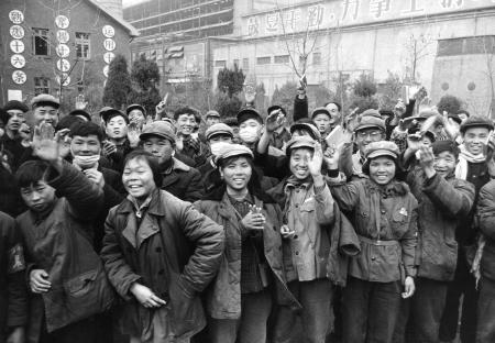 Young Chinese gathered outside a factory waving copies of the collected writings of Mao Zedong in 1967.