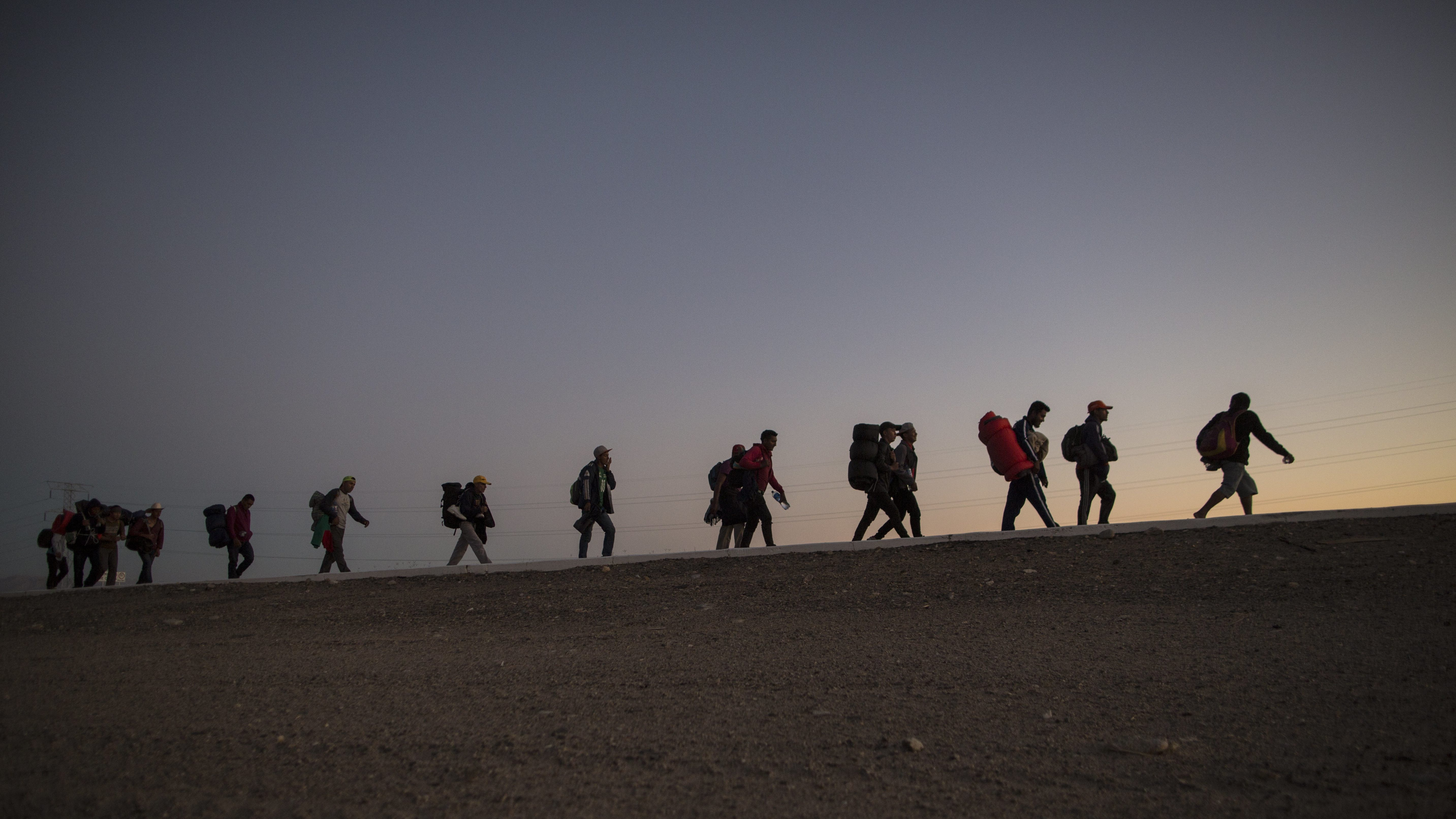 People who fled Central America walking toward the US border.