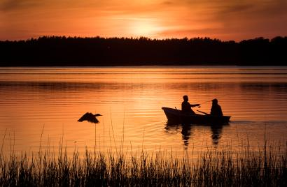 Local fishermen fish during the sunset, on the Lusiai lake near the small town of Ignalina, some 120km (74,5 miles) north of the capital Vilnius, Lithuania, Saturday, May 18, 2019. (AP Photo/Mindaugas Kulbis)