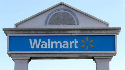 Walmart's blue sign on an archway