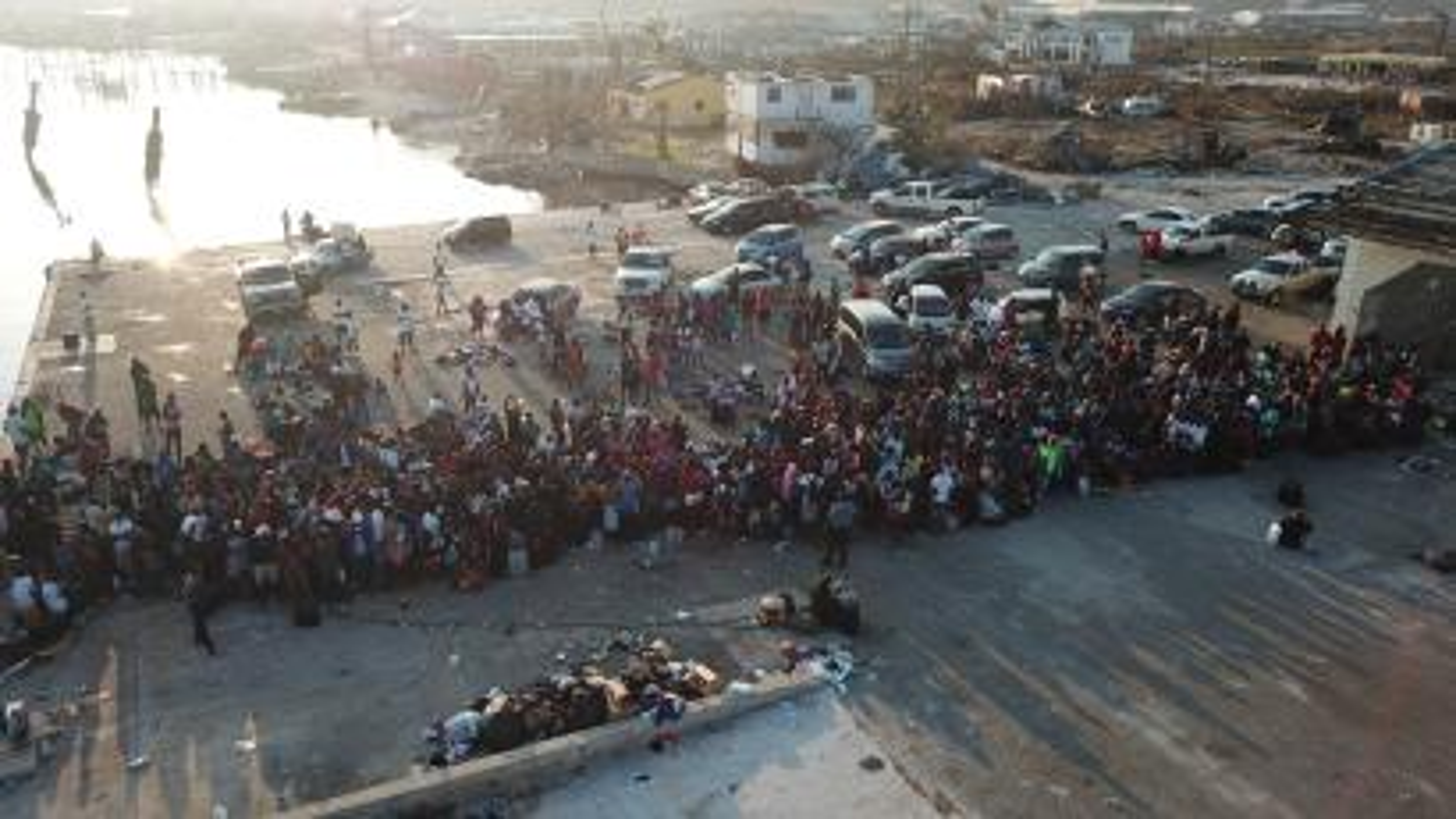 People wait to board a ferry in Freeport, Bahamas