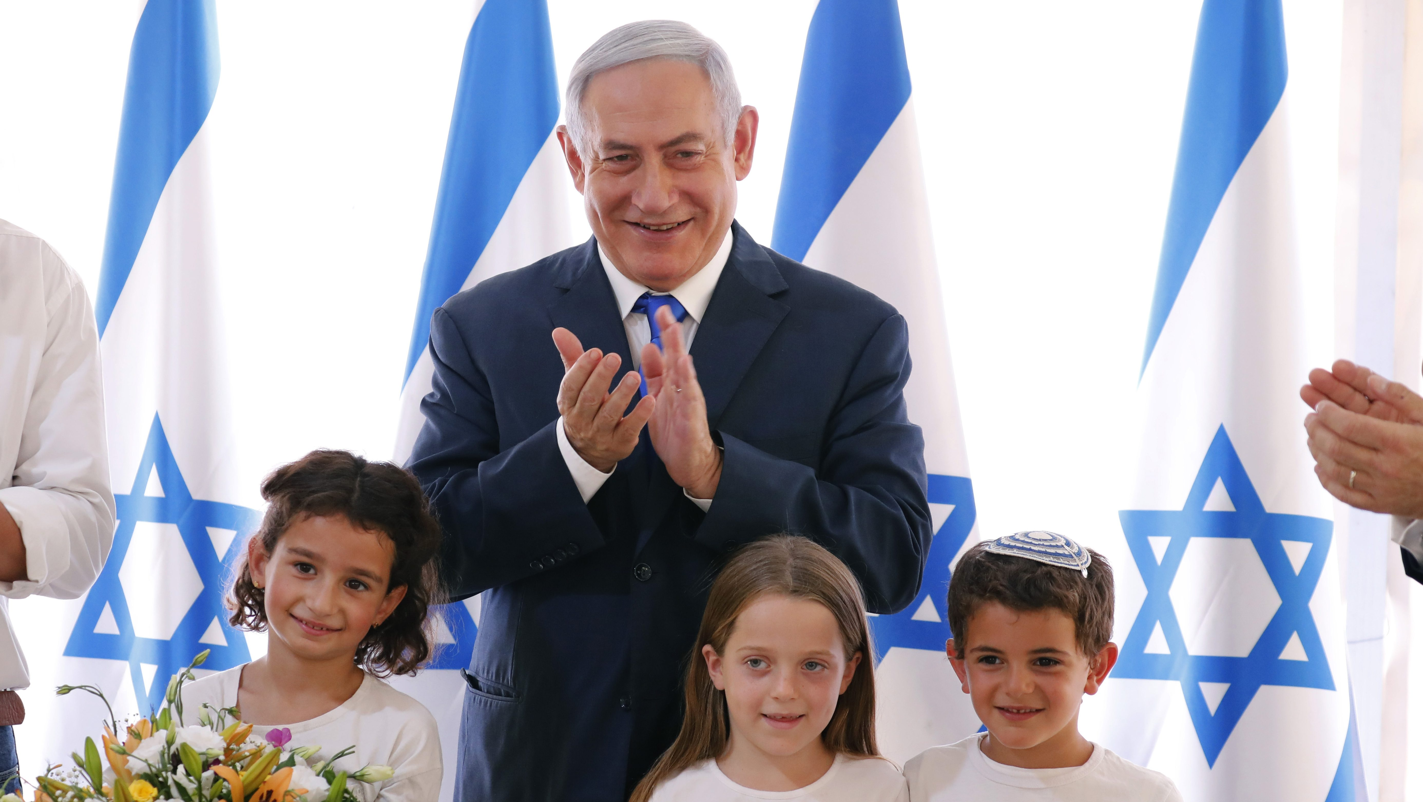 Netanyahu presented with a gift by children in the Jordan Valley. He held a cabinet meeting there last week—and has promised to annex if the area if re-elected.