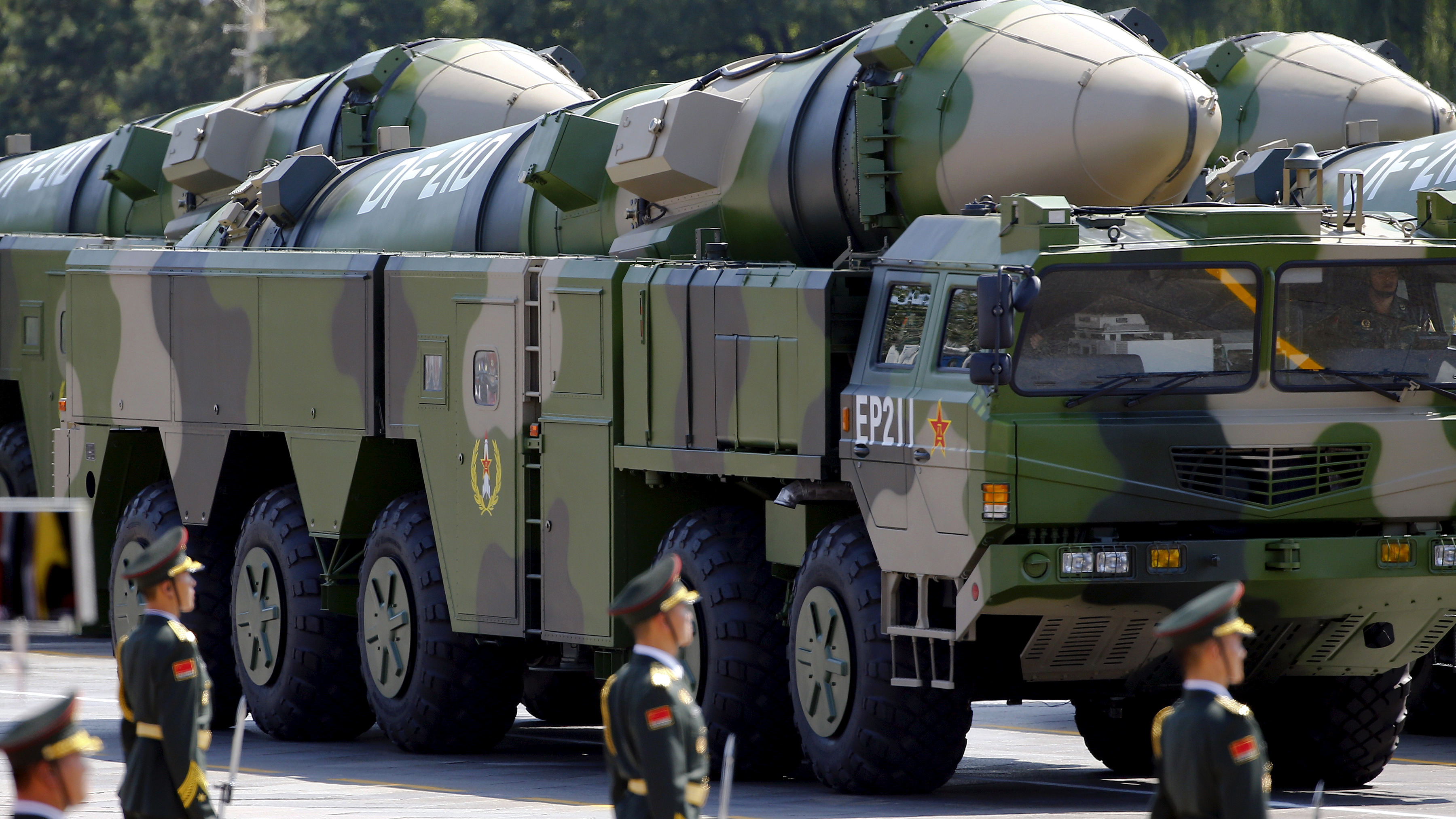 Military vehicles carrying DF-21D ballistic missiles roll to Tiananmen Square during a military parade to mark the 70th anniversary of the end of World War Two, in Beijing