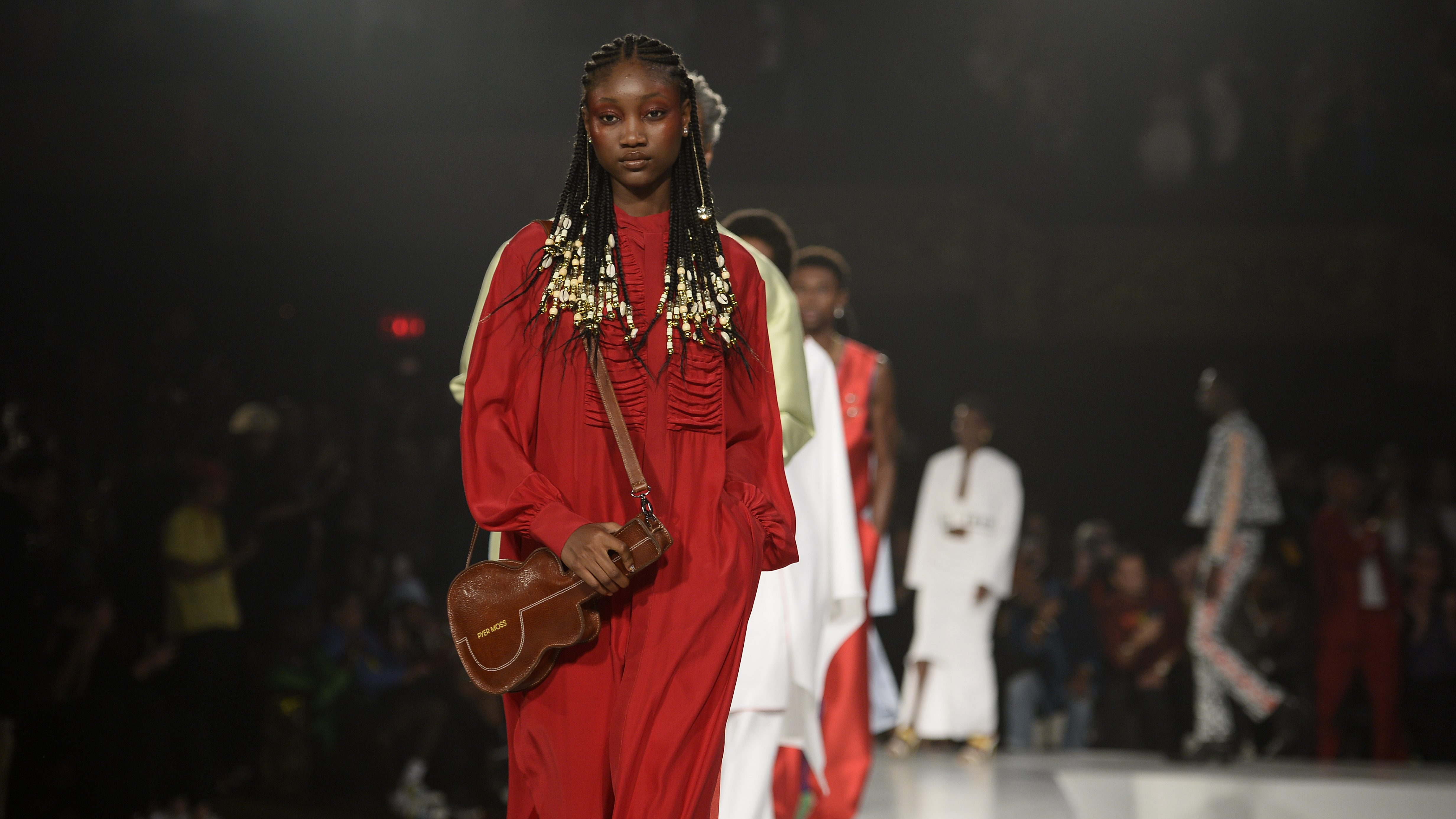 A model on the runway—with a bag in the shape of a guitar—at Pyer Moss