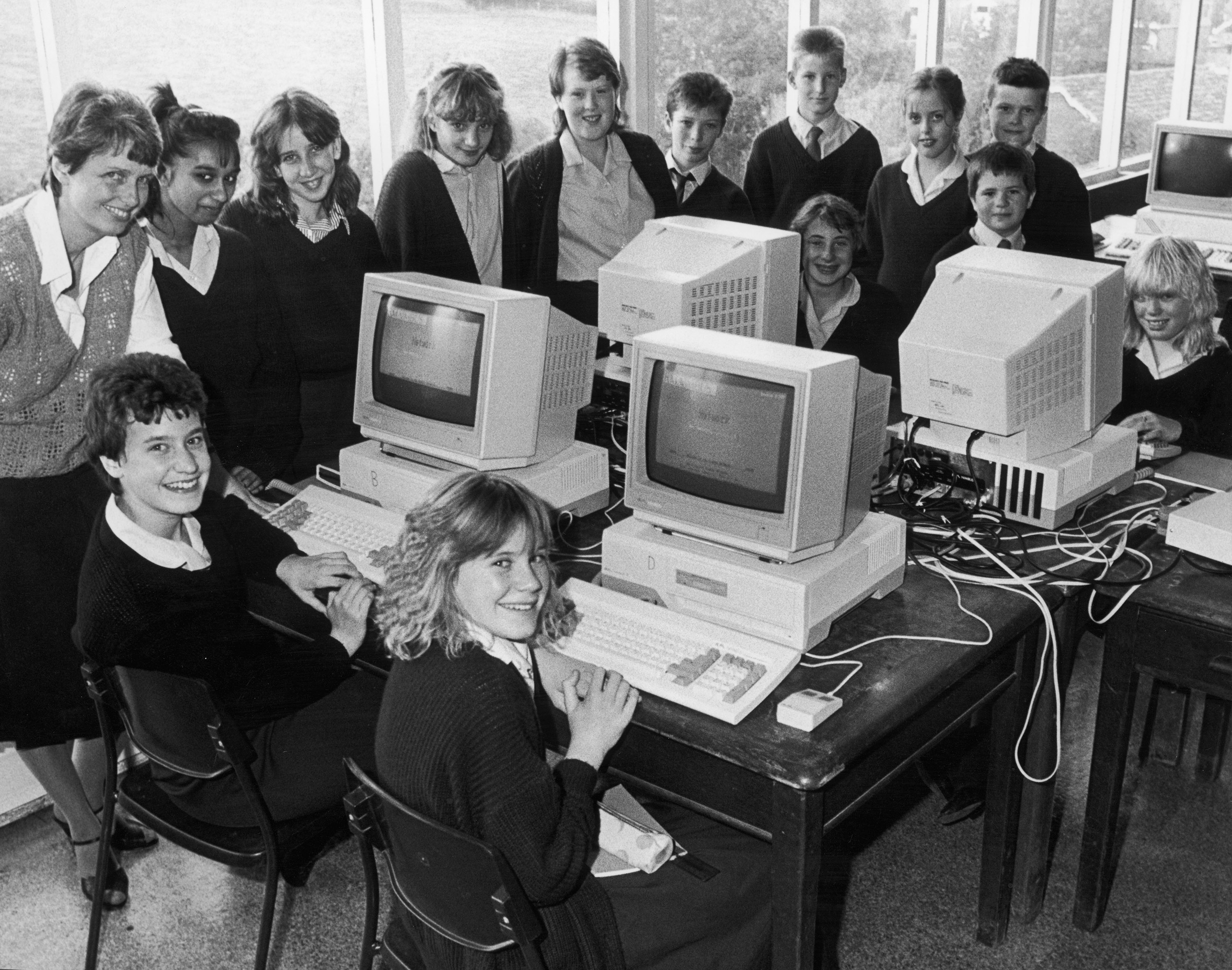 Teachers and pupils try out the new computer