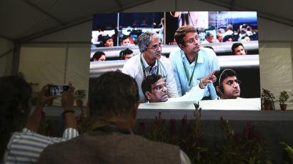 Live pictures of Indian Space Research Organization (ISRO) scientists reacting are displayed on a big screen at their Telemetry, Tracking and Command Network facility in Bangalore, India