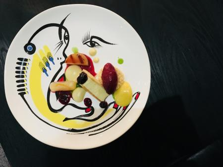 Les Créatifs - Vanilla custard mousse in a lemon wafer sable with berry sorbet and poached pear