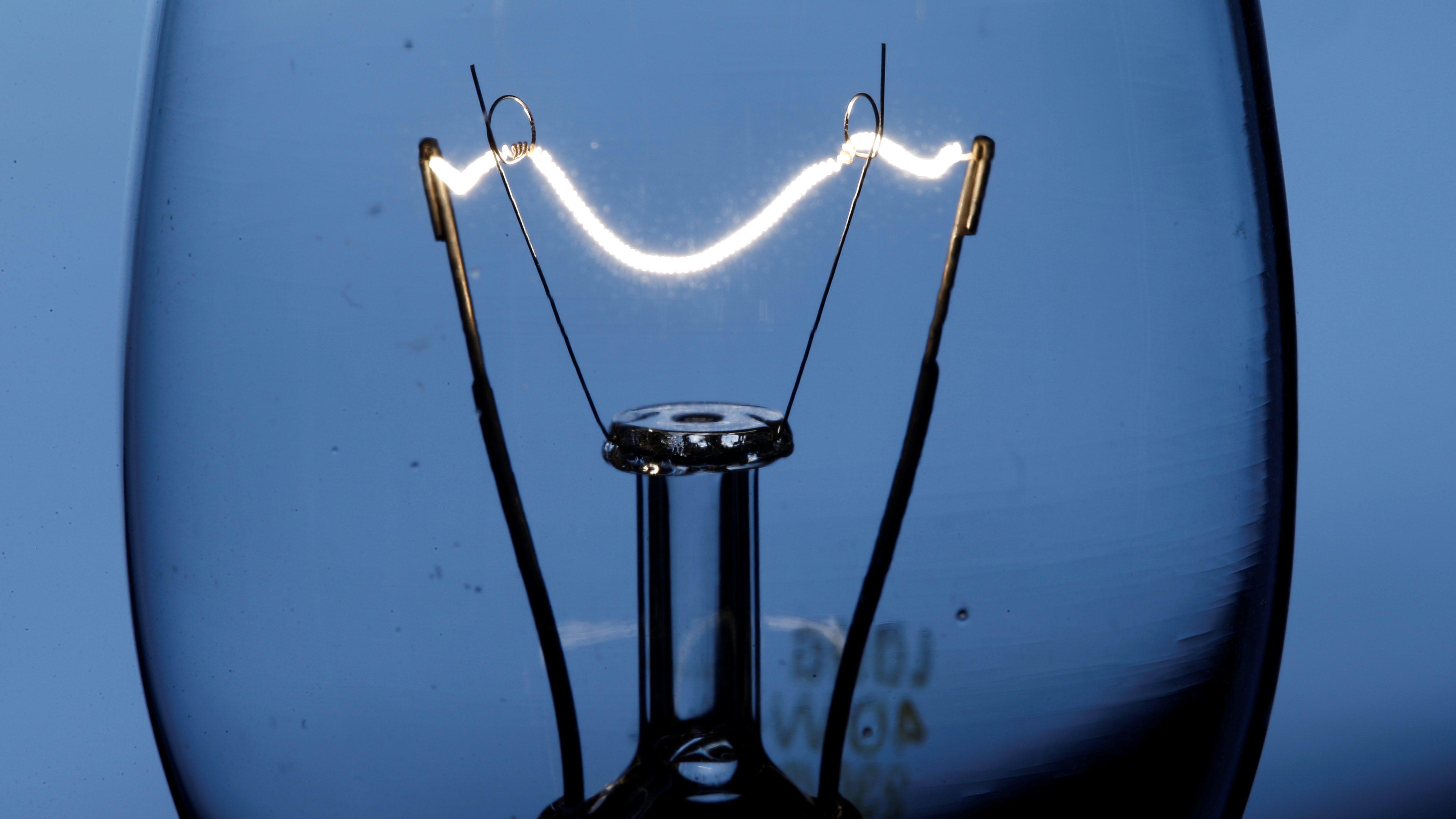The filament of an incandescent light bulb