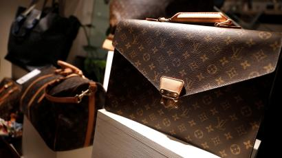 Louis Vuitton bags for sale are displayed at The RealReal shop