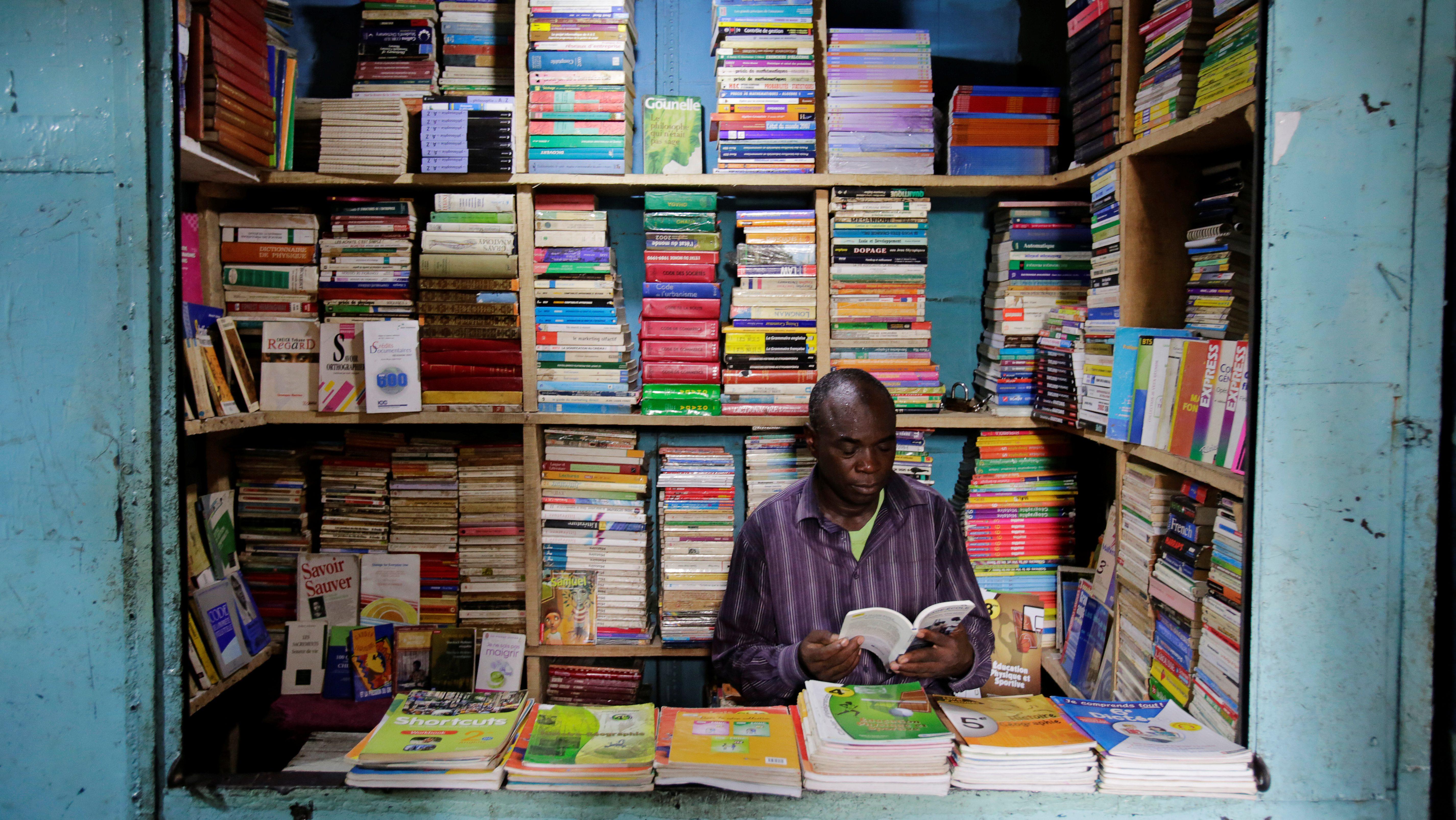 A school book seller is seen at Adjame market in Abidjan, Ivory Coast, September 13, 2018. Picture taken September 13, 2018.
