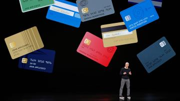 Tim Cook onstage with credit cards