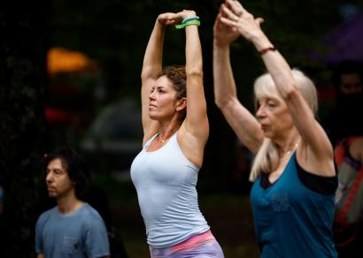 Guests take part in morning yoga during the celebration of the 50th anniversary of the Woodstock Festival on Max Yasgur's original homestead in Bethel