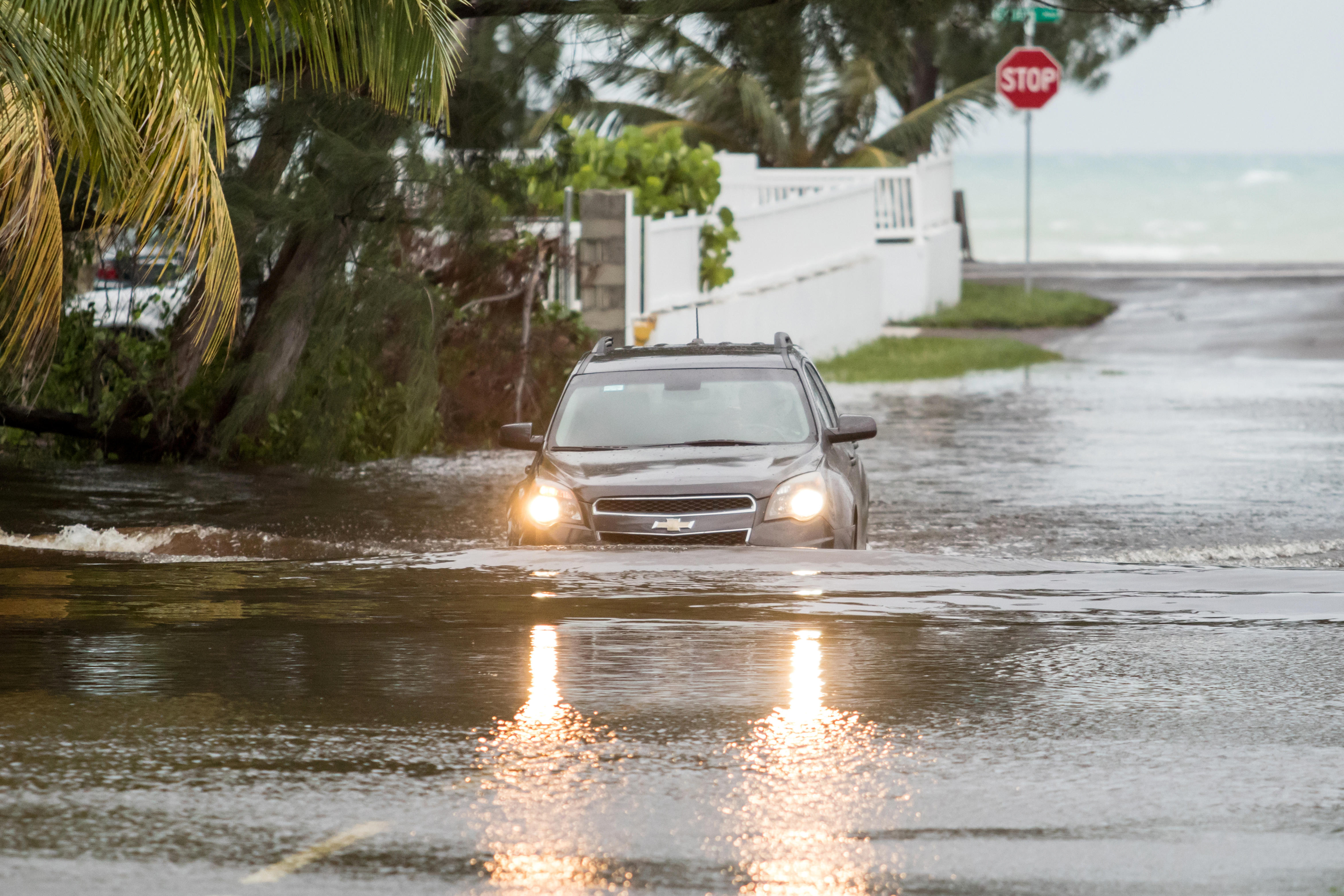 A car drives through a flooded street after the effects of Hurricane Dorian arrived in Nassau