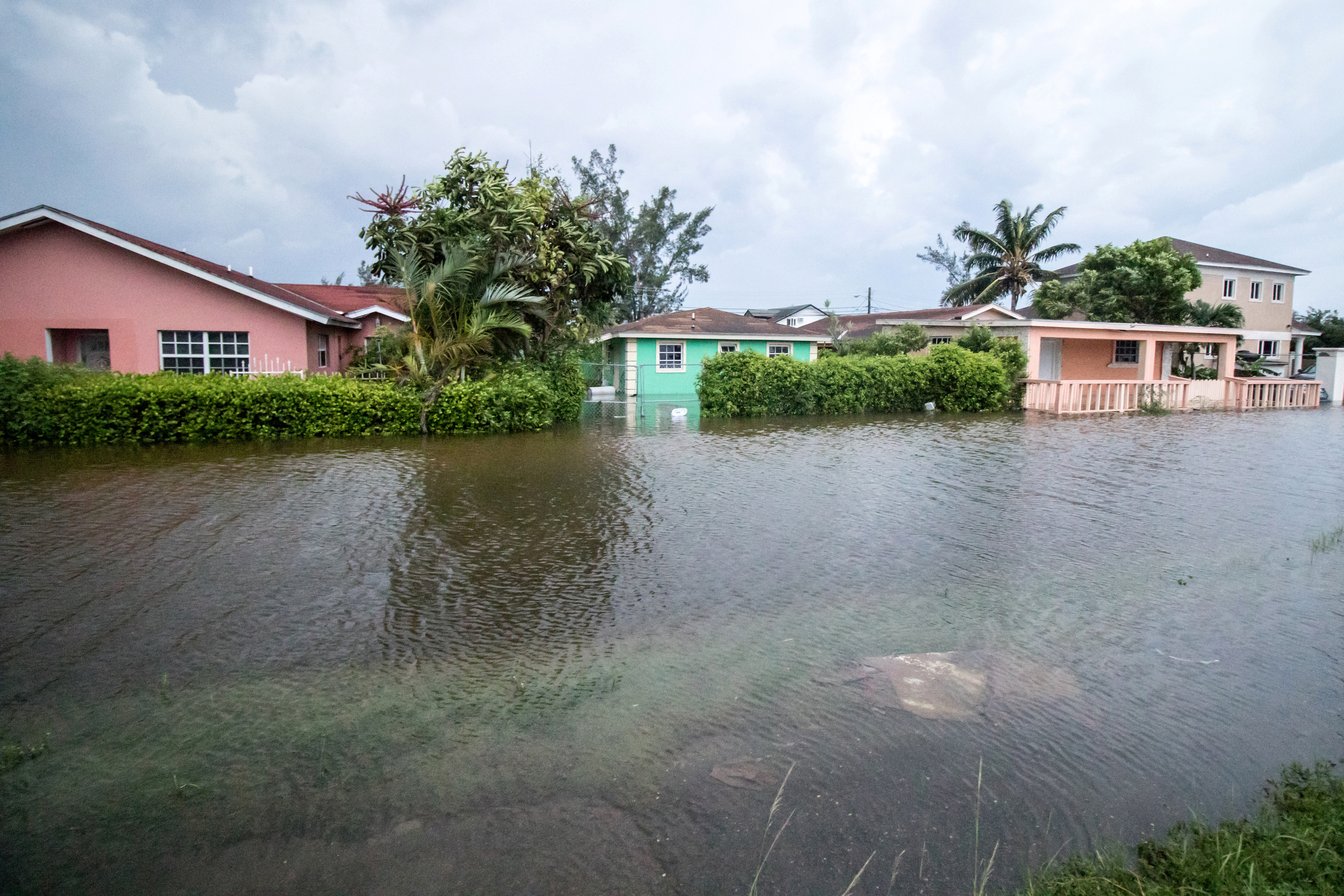 Houses line a flooded street after the effects of Hurricane Dorian arrived in Nassau, Bahamas on September 2.
