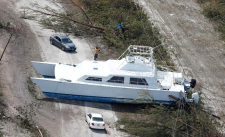 A boat lays across a road after hurricane Dorian hit the Grand Bahama Island, seen on Sept. 4.