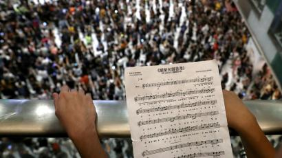 A participant holds sheet music of Hong Kong's anthem during a protest at New Town Plaza shopping mall in Hong Kong, China September 11, 2019.