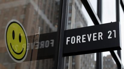 A smiley face looking happy next to the Forever 21 sign at its New York store
