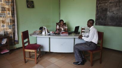 Gbianza, director of the national radio, receives a guest in her office at the radio headquarters in Bangui, Central African Republic