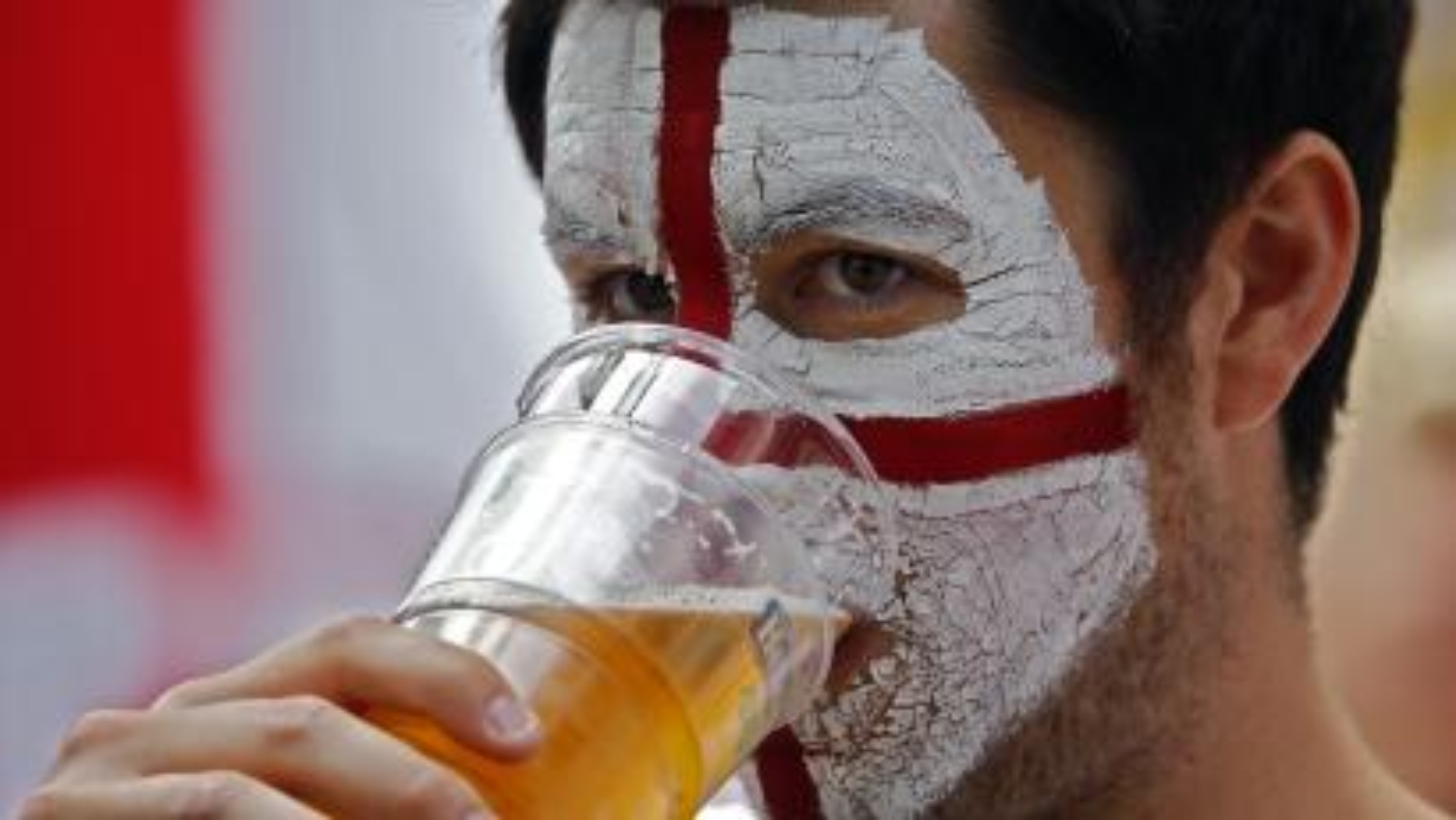 Football Soccer -EURO 2016 - Saint Etienne, France -20/6/16 -An England fan sips beer in Saint Etienne, France.