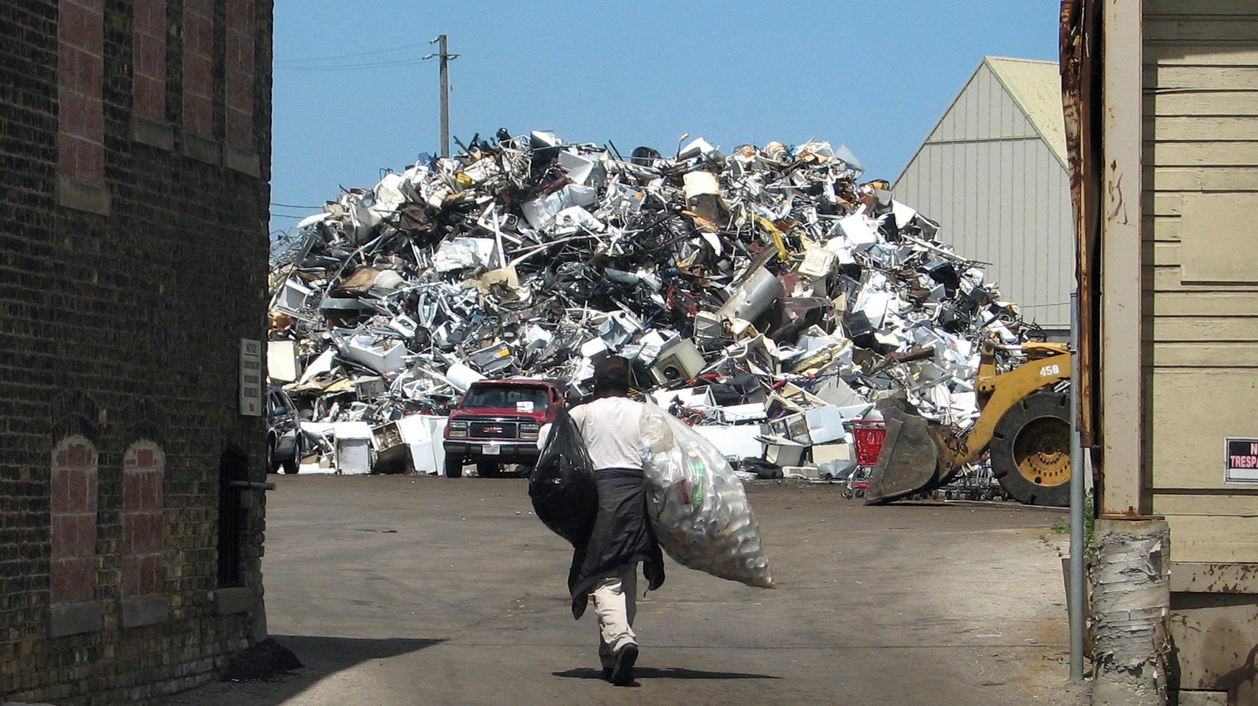 A scrapper heads toward a mountain of metal at a scrap yard in Milwaukee