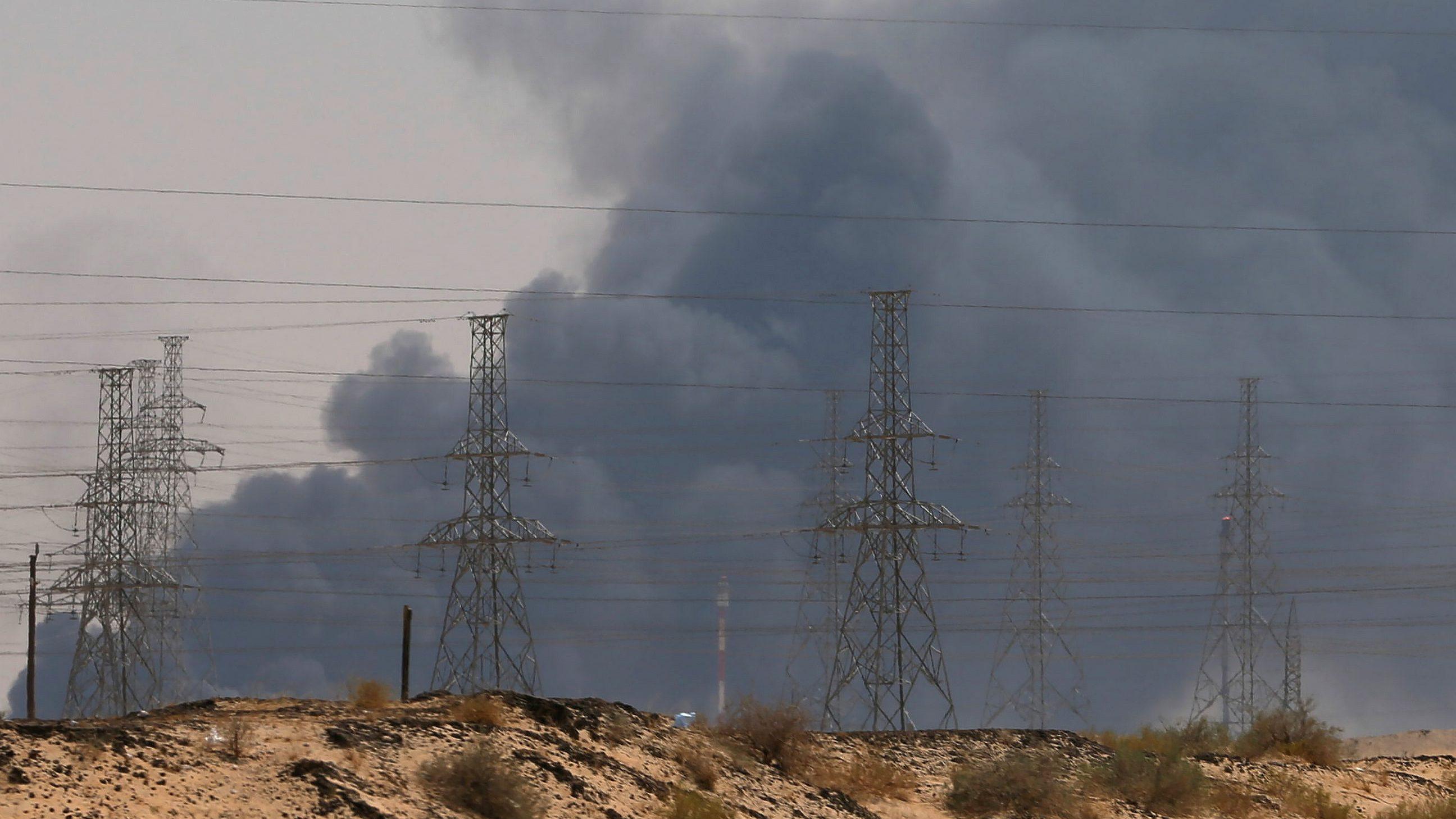 Smoke is seen following a fire at an Aramco factory in Abqaiq, Saudi Arabia, September 14, 2019.