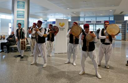 Members of a traditional music group perform as tourists traveling with the Thomas Cook travel agency arrive at the Enfidha Airport in Enfidha, Tunisia February 14, 2018.