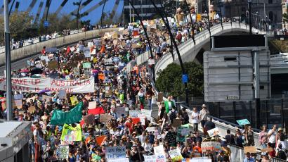 Climate change protesters are seen crossing the Victoria Bridge during the Global Strike 4 Climate rally in Brisbane