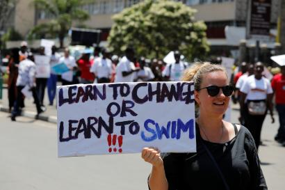 An environmental activist holds a sign as she takes part in the Climate strike protest calling for action on climate change, in Nairobi, Kenya, September 20, 2019.