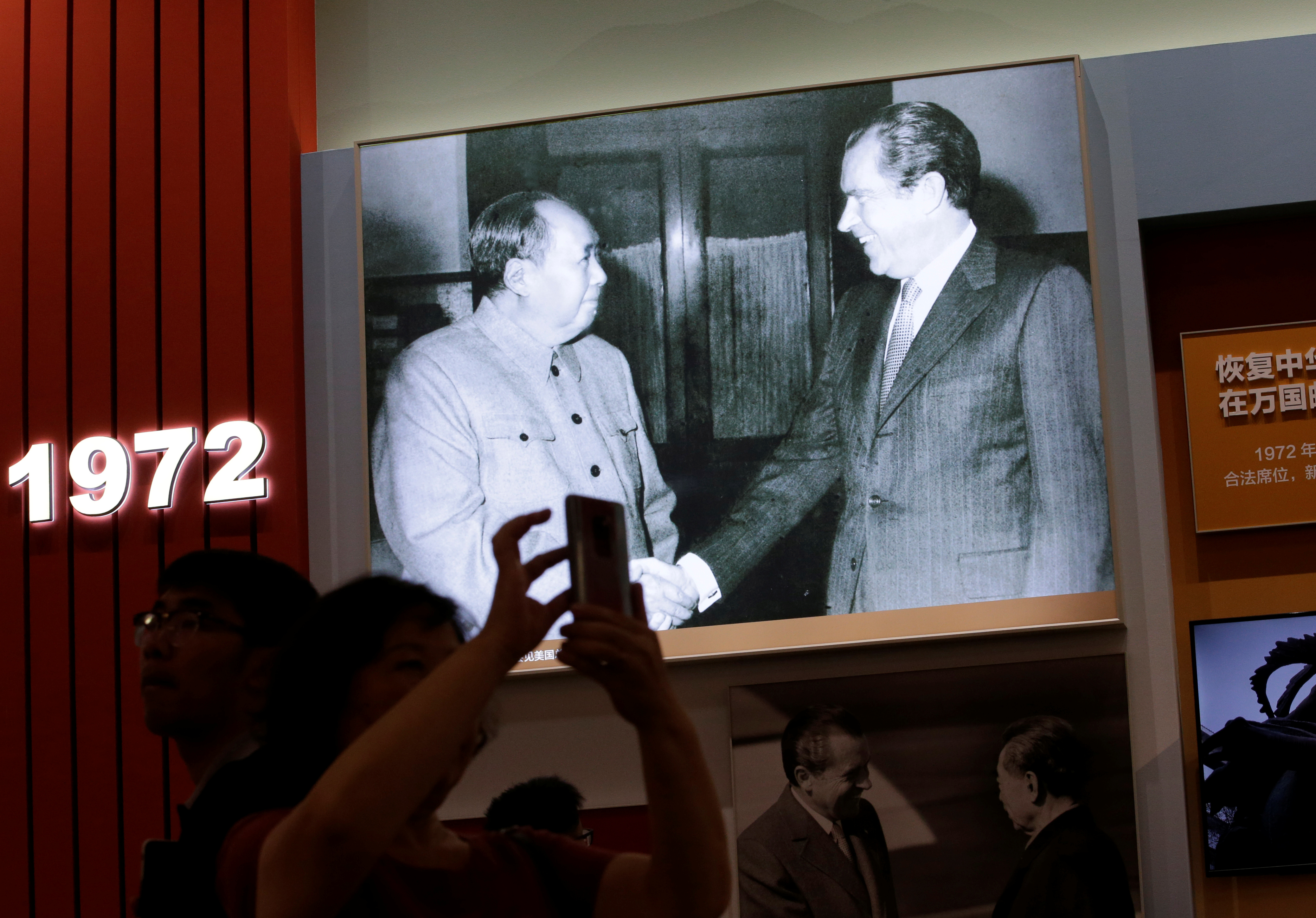 Visitors are seen in front of exhibits showing the U.S. president Richard Nixon's 1972 visit to China, during an exhibition on China's achievements marking the 70th anniversary of the founding of the People's Republic of China (PRC) at the Beijing Exhibition Center, in Beijing, China September 24, 2019.