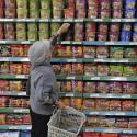 A customer selects instant noodles at a supermarket in Yinchuan