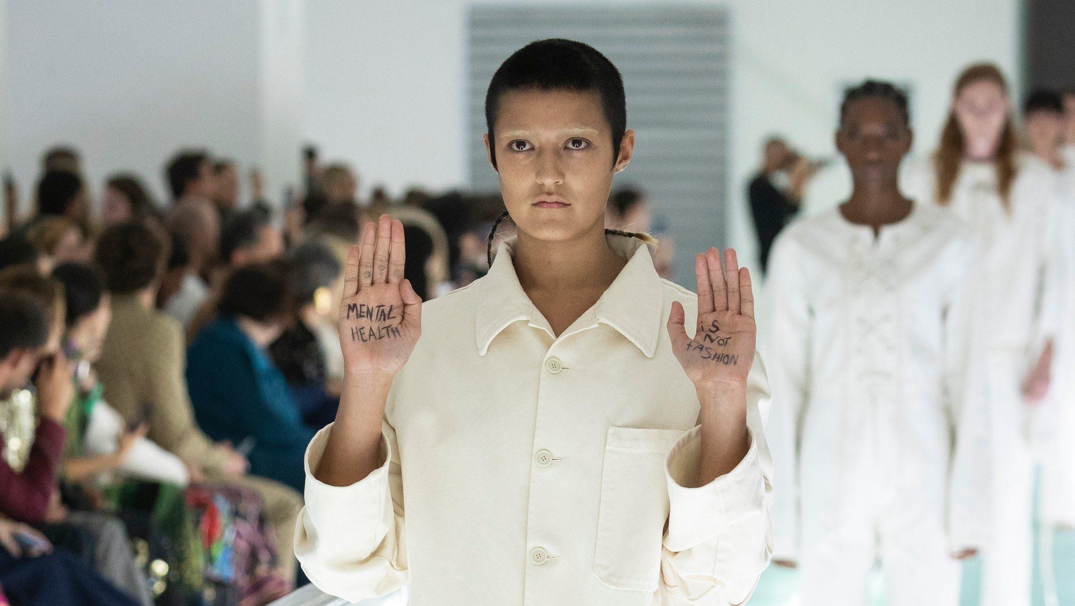 Gucci model protests its use of straitjackets at Milan Fashion Week