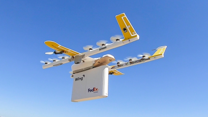 The Wing drone delivering a FedEx package.