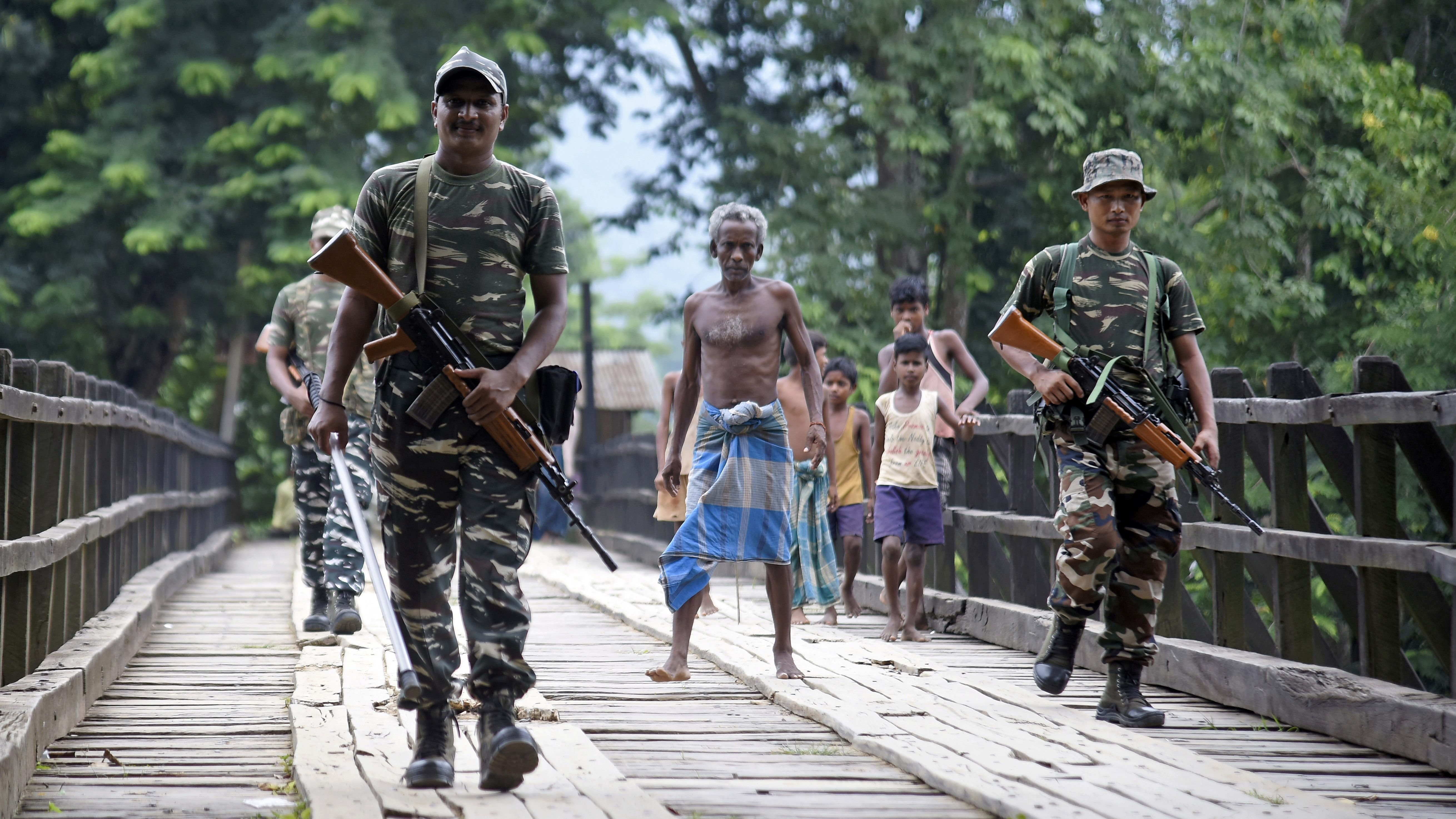 Indian security personnel patrol on a road ahead of the publication of the final draft of the National Register of Citizens (NRC) at Kachari Para village, in Hojai district, northeastern state of Assam, India