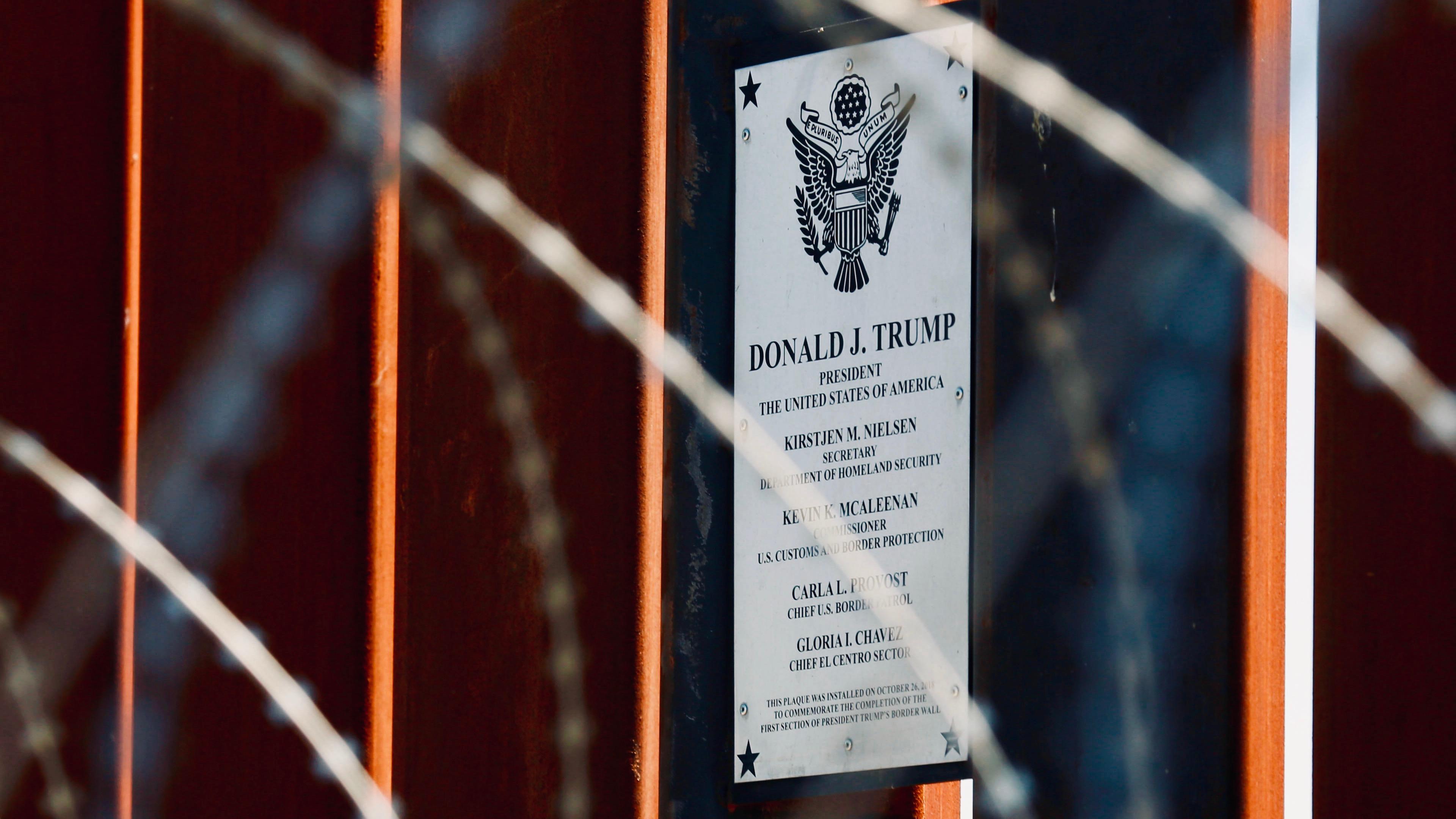 US President Donald Trump plaque at the U.S.-Mexico border in Calexico, California