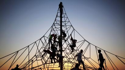 Children play at sunset on a construction in Israel.