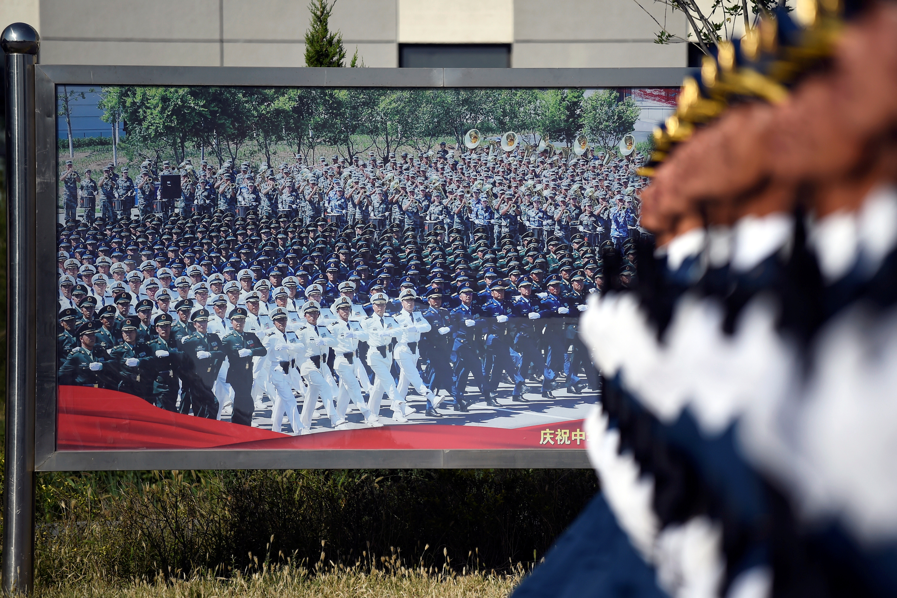 Chinese troops practice marching ahead of a October 1 military parade to celebrate the 70th anniversary of the founding of the People's Republic of China on the outskirts of Beijing, China September 25, 2019.
