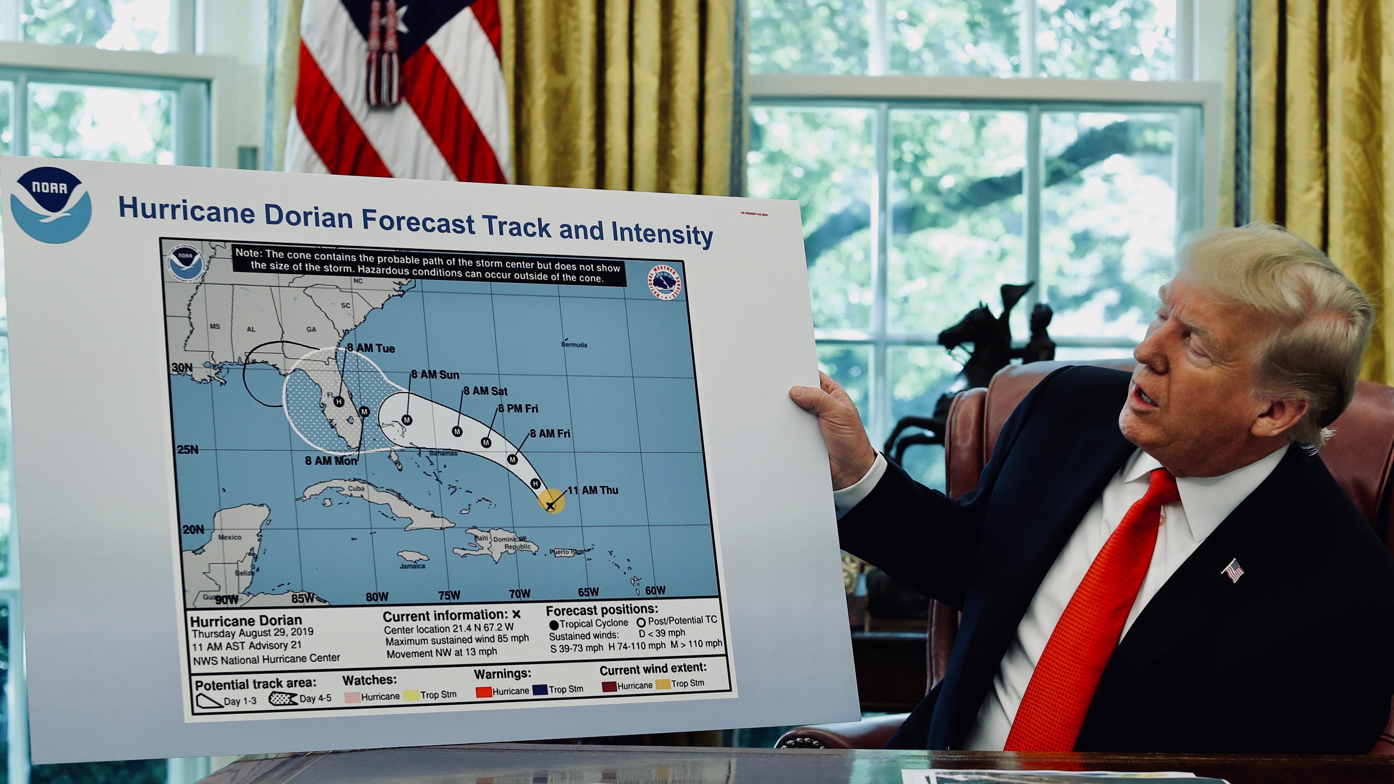 U.S. President Trump receives a Hurricane Dorian update at the White House in Washington.
