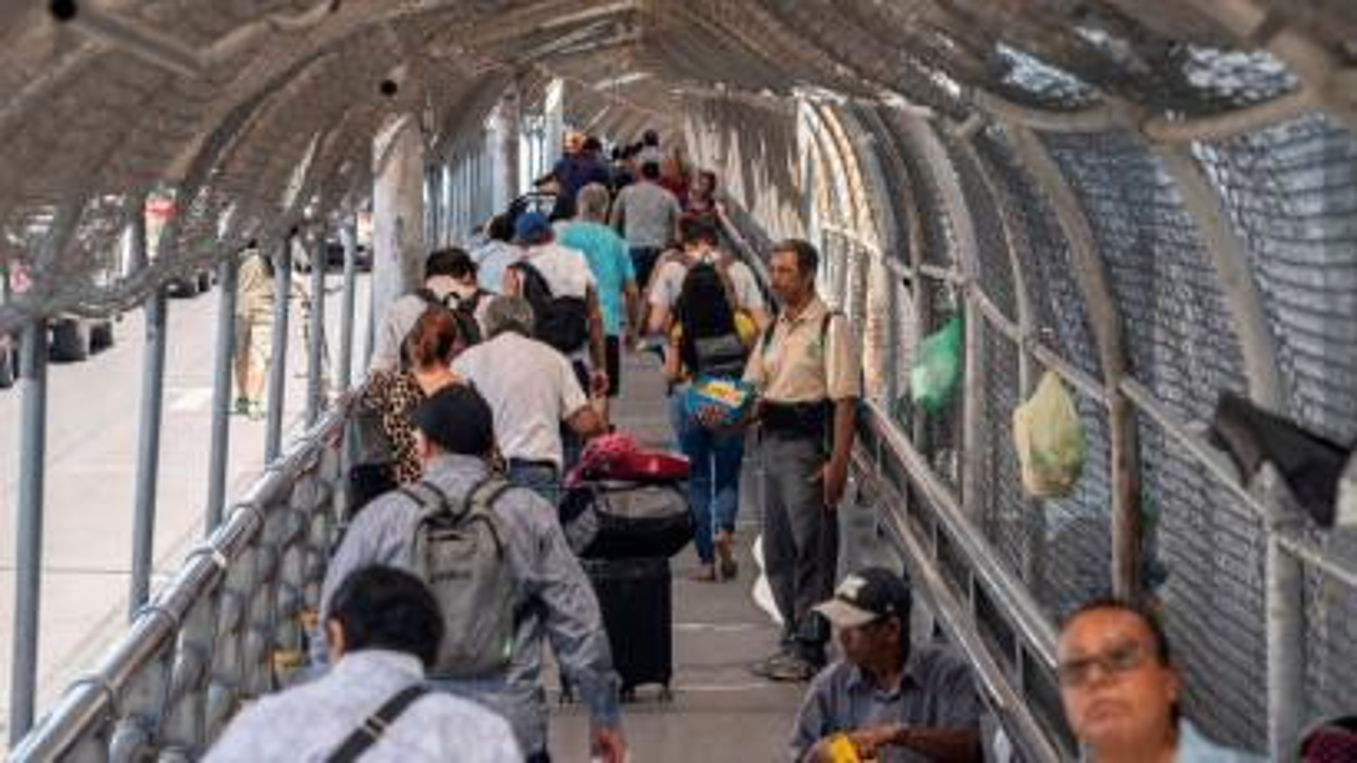Migrants on a cross-border bridge